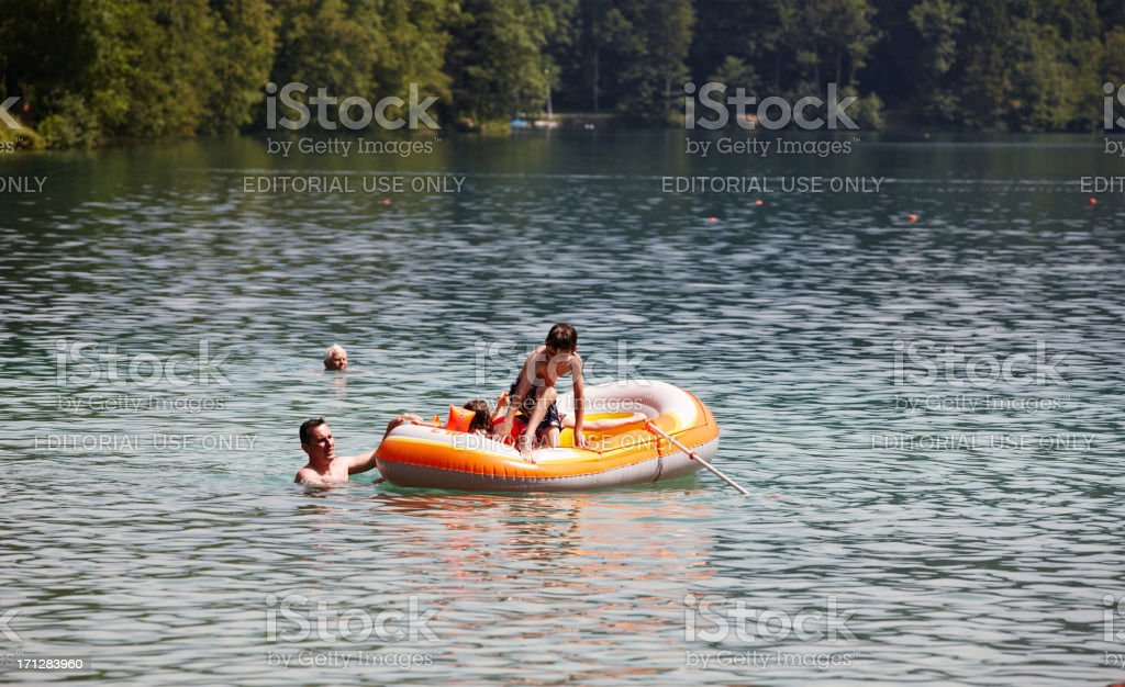 Boy jumping into the lake royalty-free stock photo