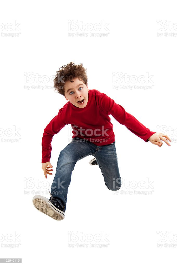 Boy jumping isolated on white background royalty-free stock photo