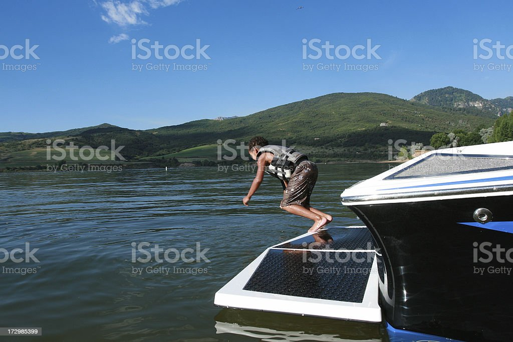 Boy jumping off Boat royalty-free stock photo