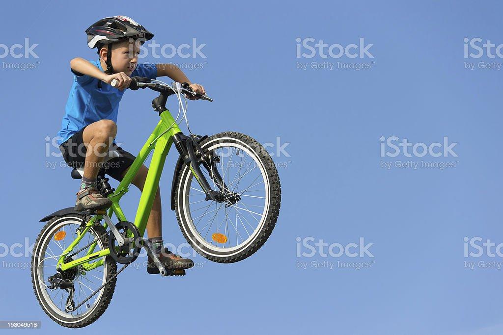 Boy jumping on bike stock photo