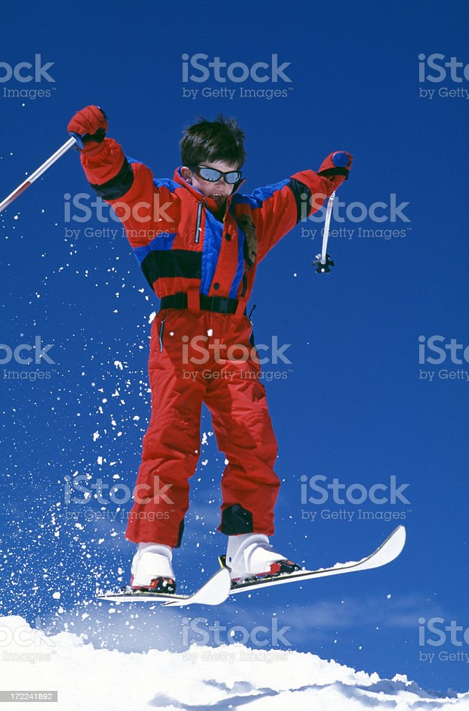 Boy Jumping on Snow Skis royalty-free stock photo