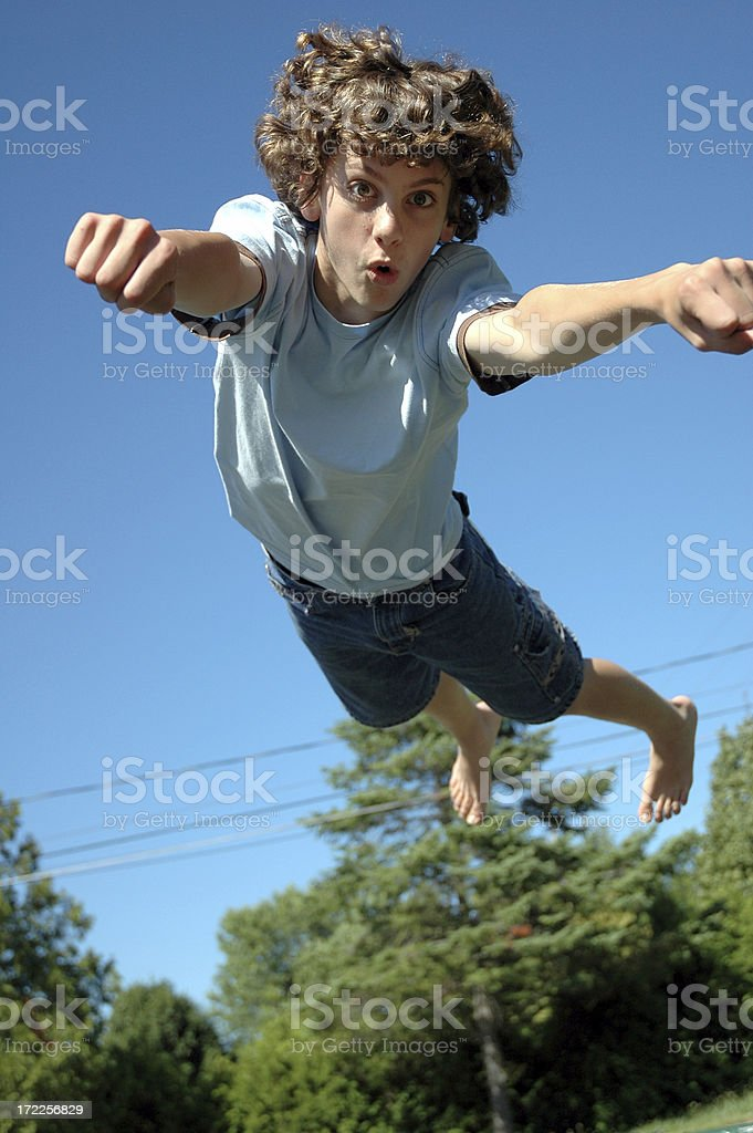 Boy Jumping on Trampoline royalty-free stock photo