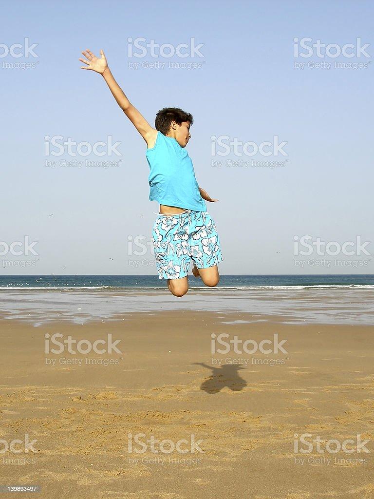 Boy jumping royalty-free stock photo