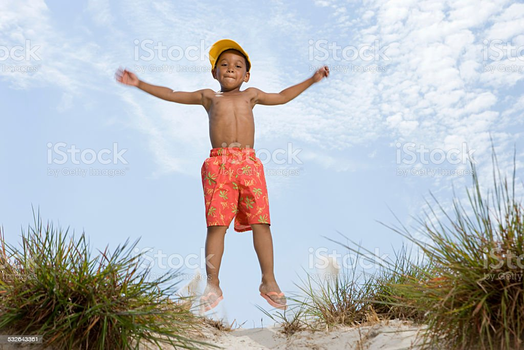 Boy jumping stock photo