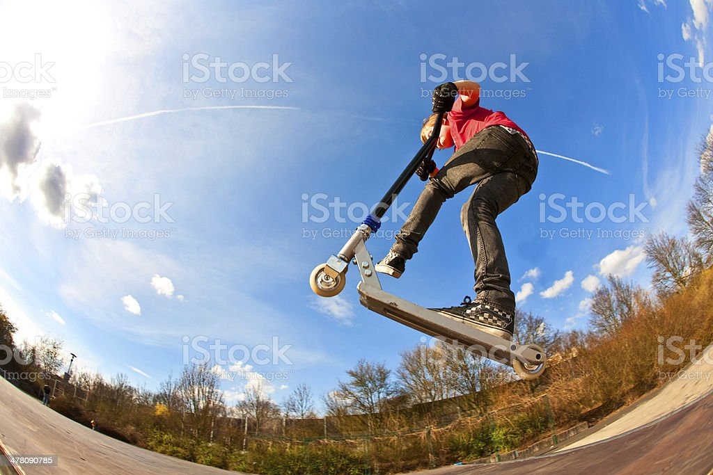 boy jumping with a scooter stock photo