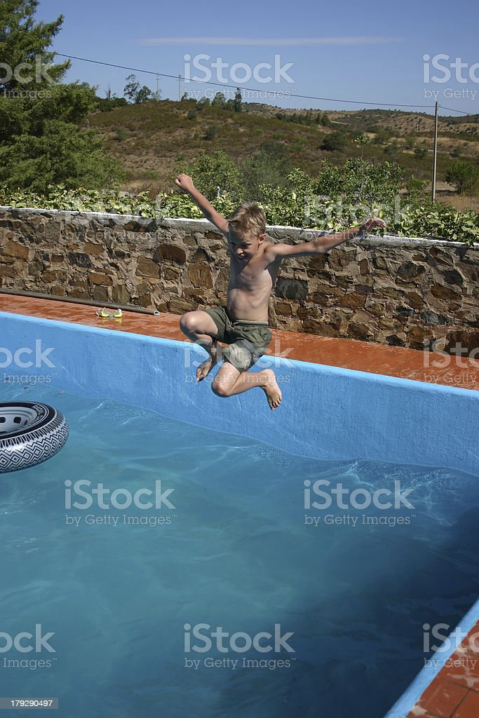 Boy jumps in the pool royalty-free stock photo