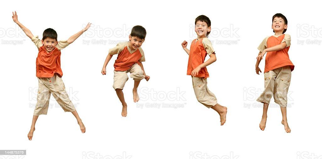 Boy jumps on white background. stock photo