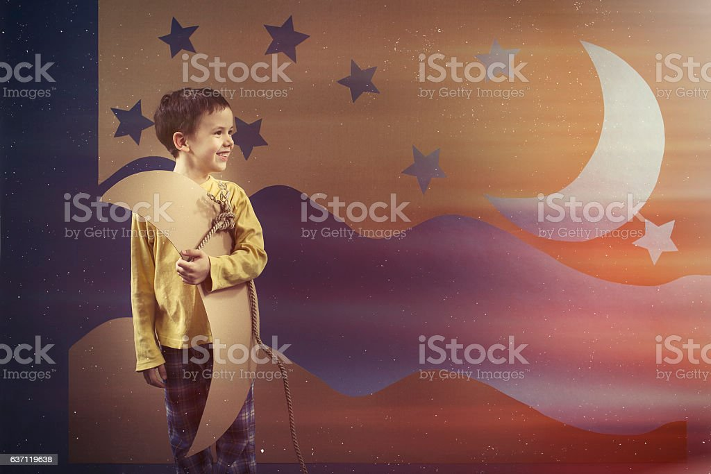 Boy keeping the paper moon stock photo