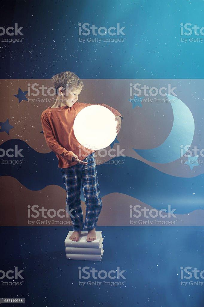 Boy keeping the shining ball stock photo