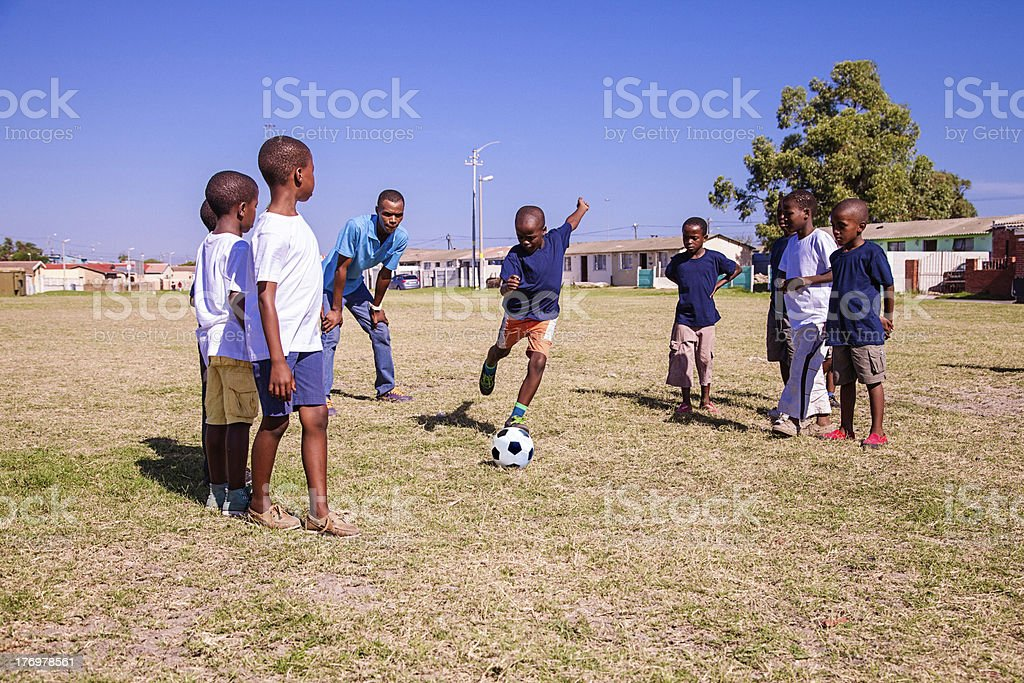 Boy kicking a penalty, Gugulethu, Cape Town, South Africa royalty-free stock photo