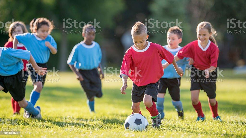 Boy Kicking a Soccer Ball stock photo