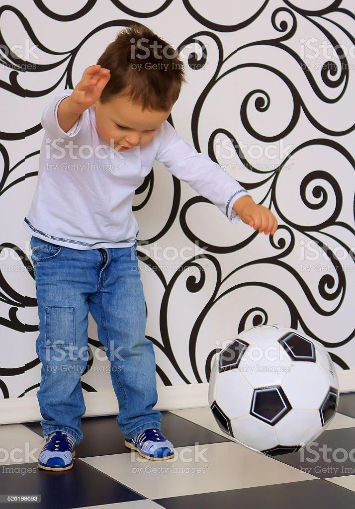 boy kicking ball stock photo