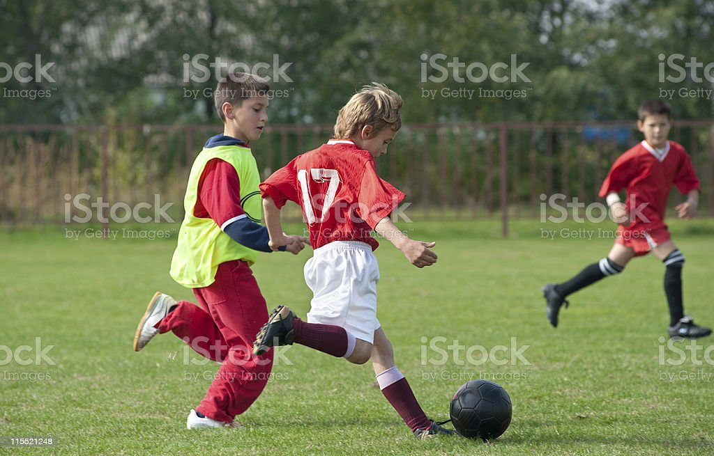 boy kicking football royalty-free stock photo