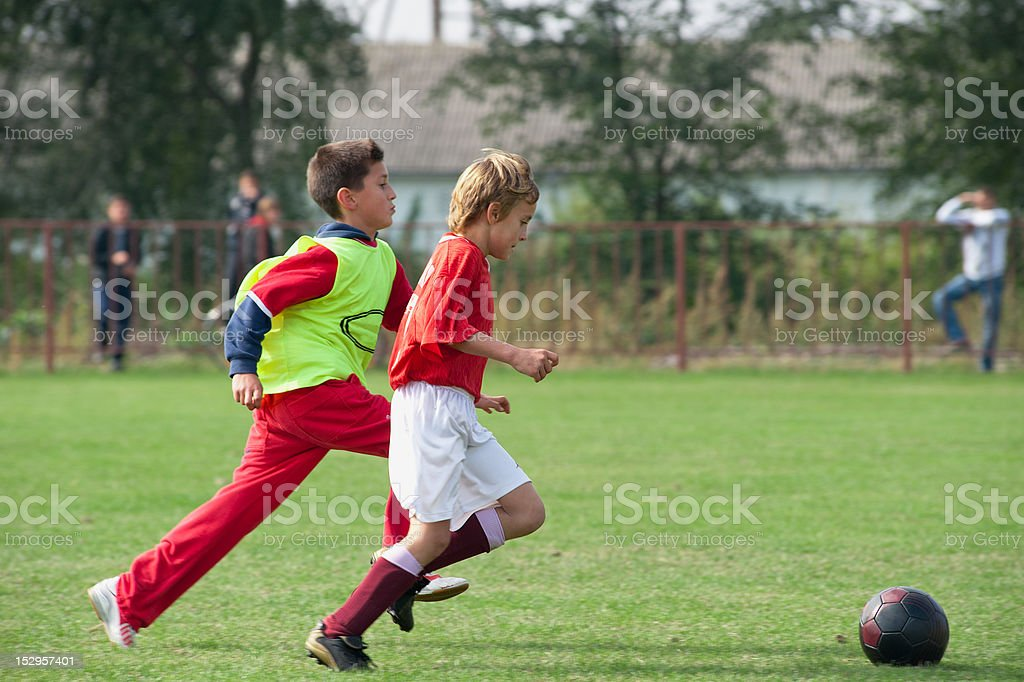 boy kicking football royalty-free stock photo