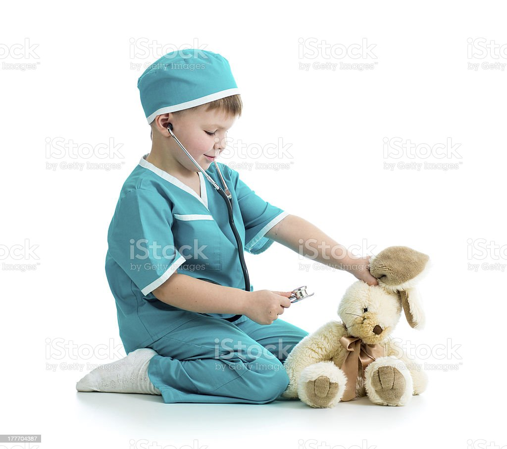 boy kid playing doctor with toy stock photo