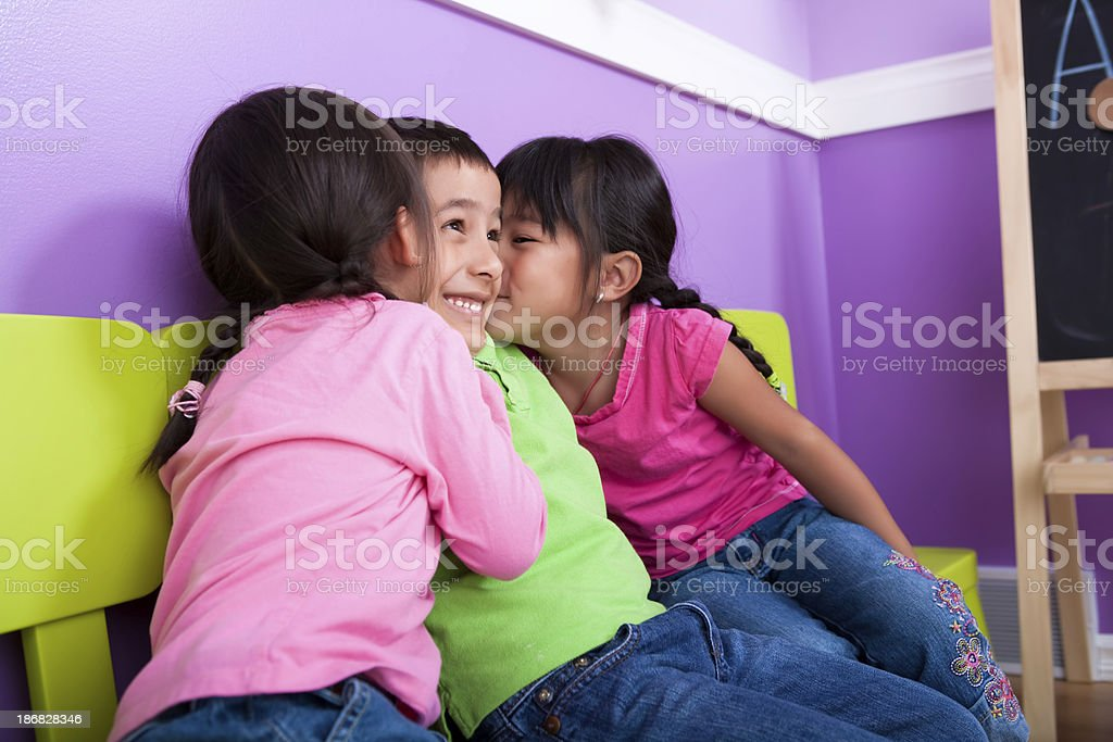 Boy kissed by two girls royalty-free stock photo