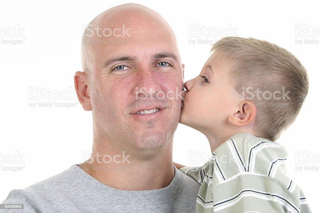 Boy Kissing Dad On Cheek royalty-free stock photo
