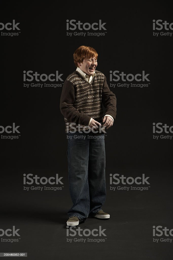 Boy (11-13) laughing stock photo