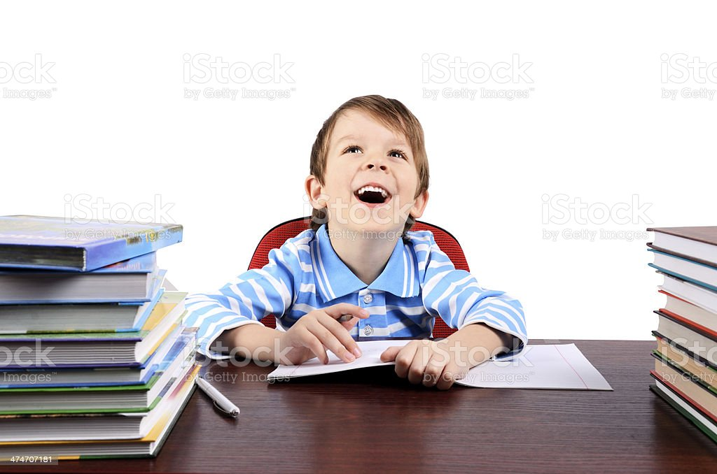 boy laughing while sitting at the desk royalty-free stock photo