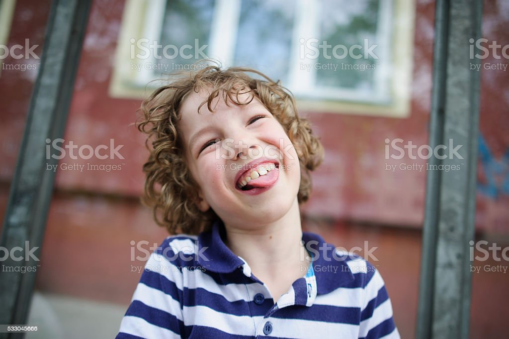 Boy laughing with his tongue out stock photo