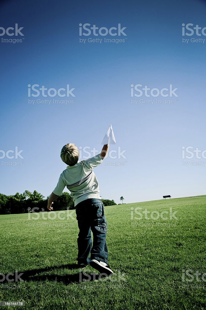Boy launching a paper airplane. royalty-free stock photo
