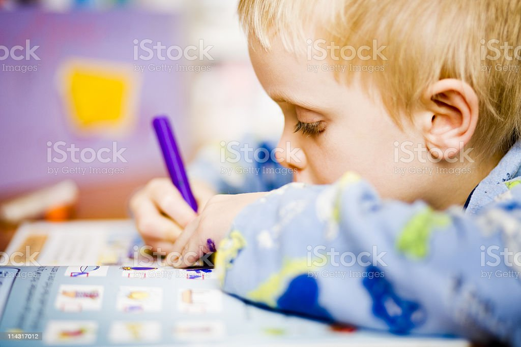 Boy learning to write royalty-free stock photo