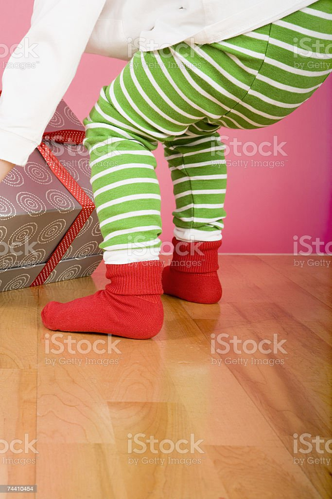 Boy lifting present royalty-free stock photo