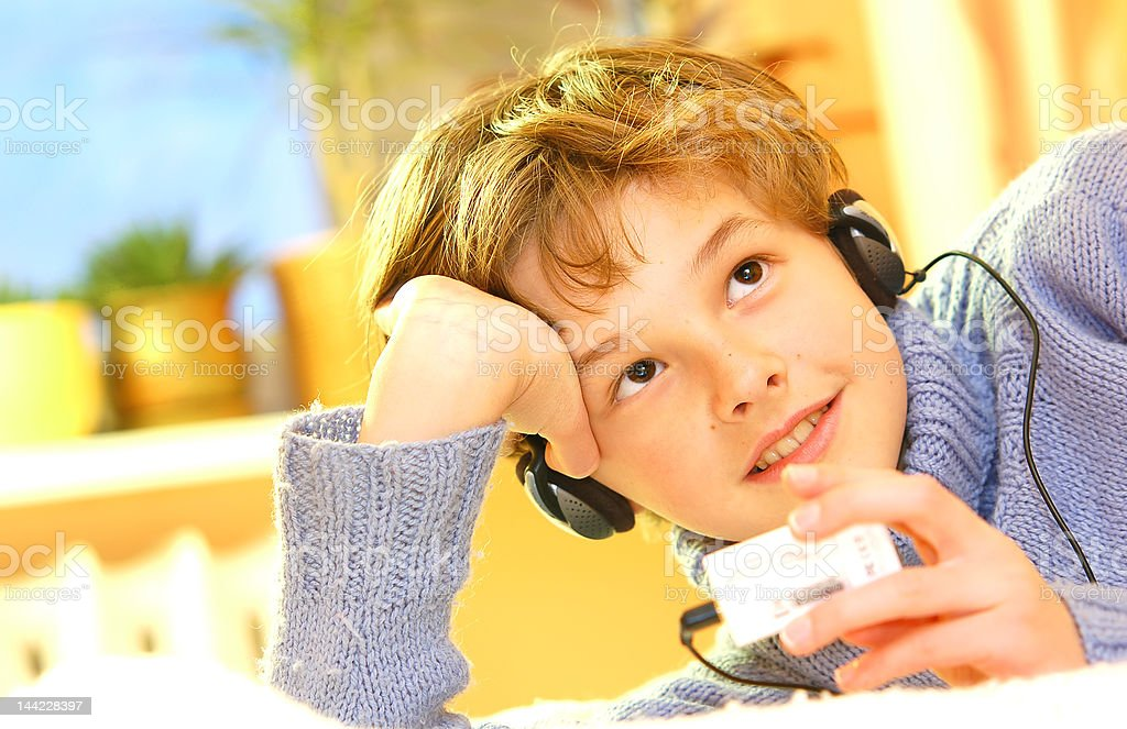 Boy listen to music royalty-free stock photo