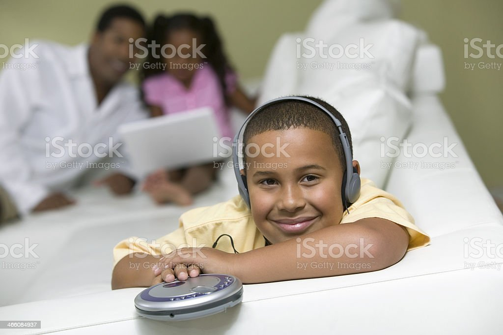 Boy Listening to Music on Headphones stock photo