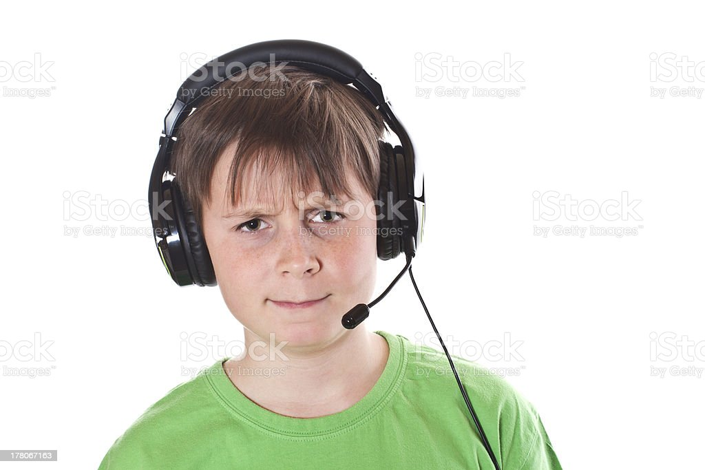 Boy listening to music with headphones royalty-free stock photo