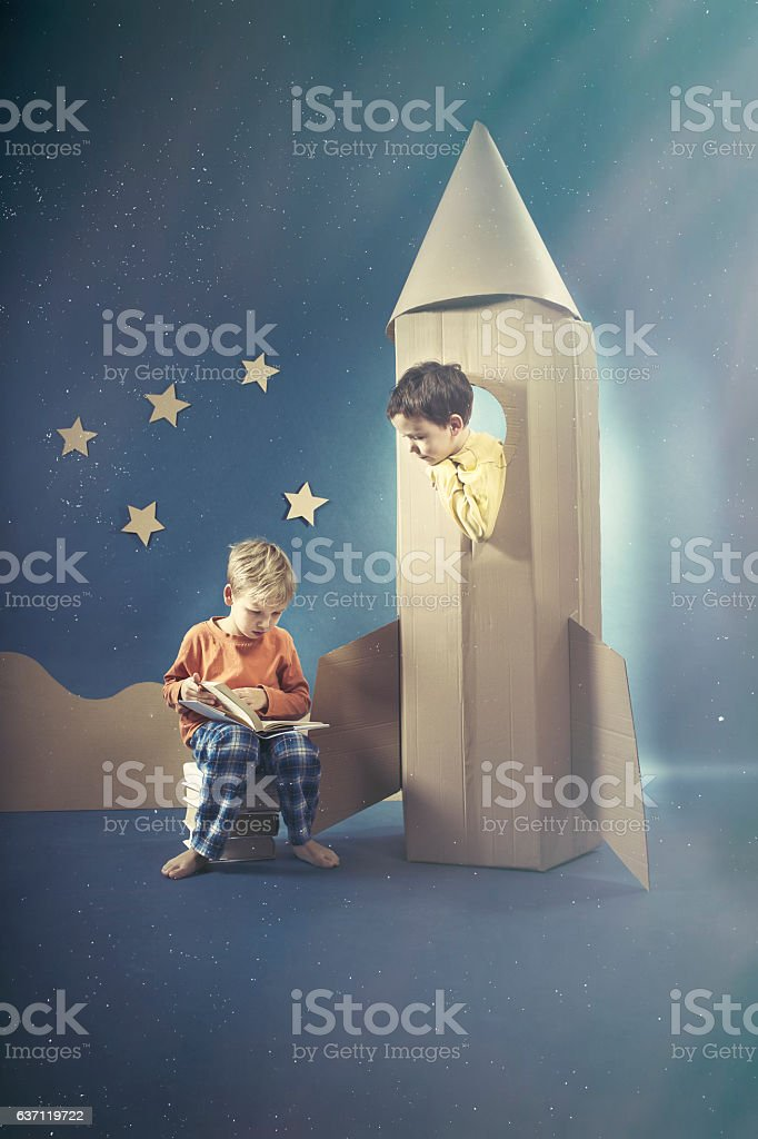 Boy looking at his friend stock photo
