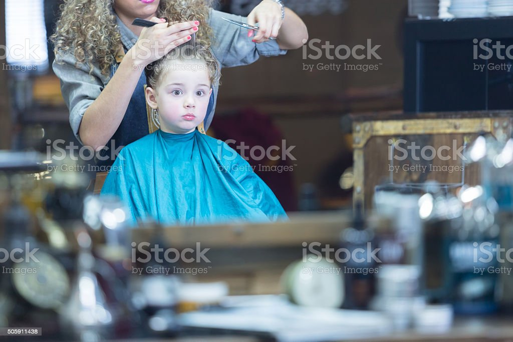 Boy looking at mirror with surprise stock photo