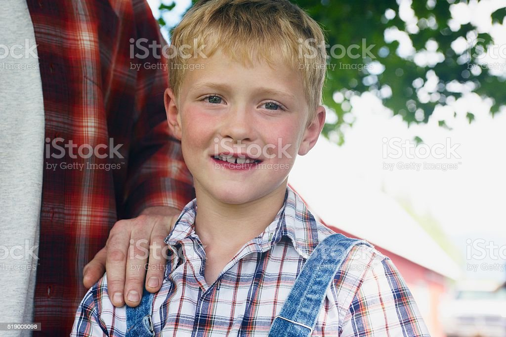 Boy looking at the camera stock photo