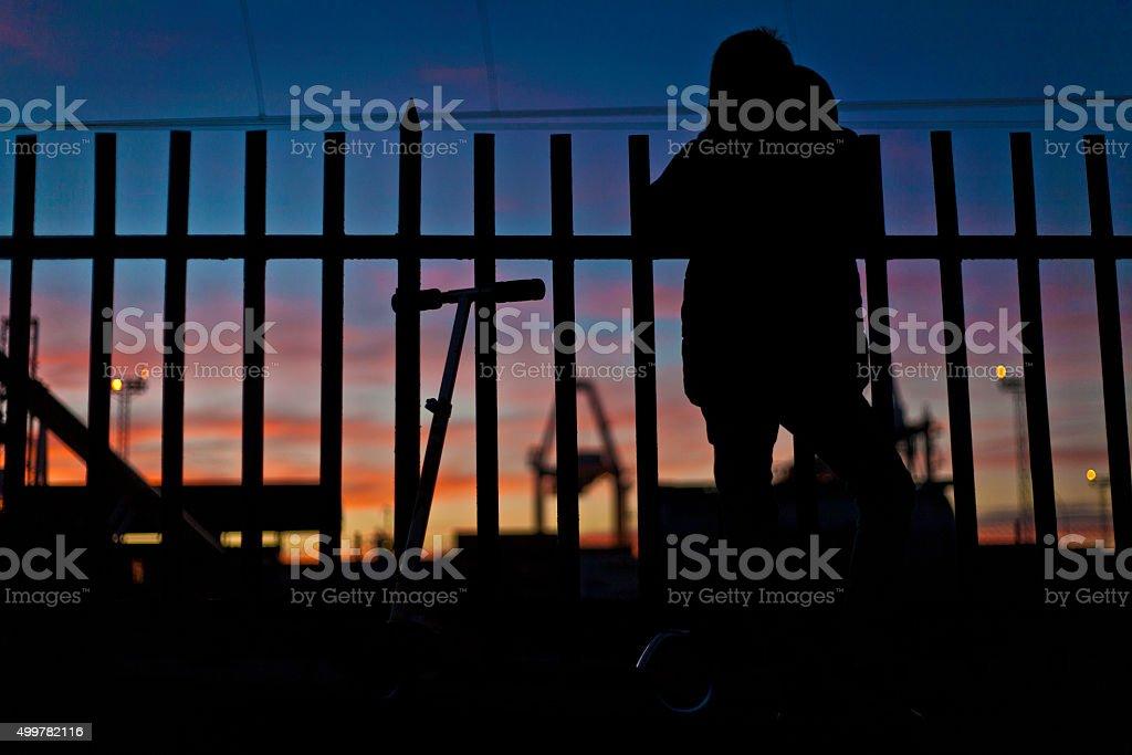 boy looking de railway stock photo