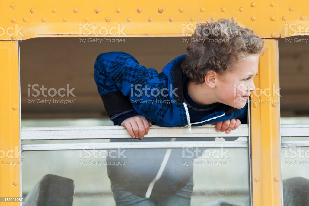 Boy looking out school bus window royalty-free stock photo