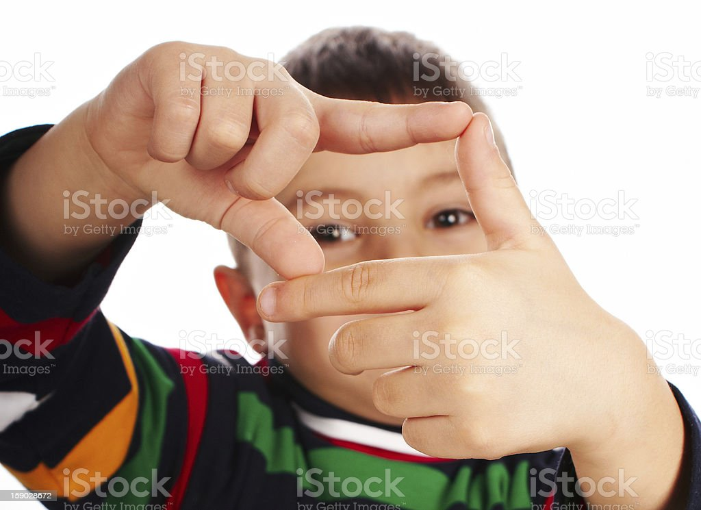 Boy looking through a finger frame royalty-free stock photo