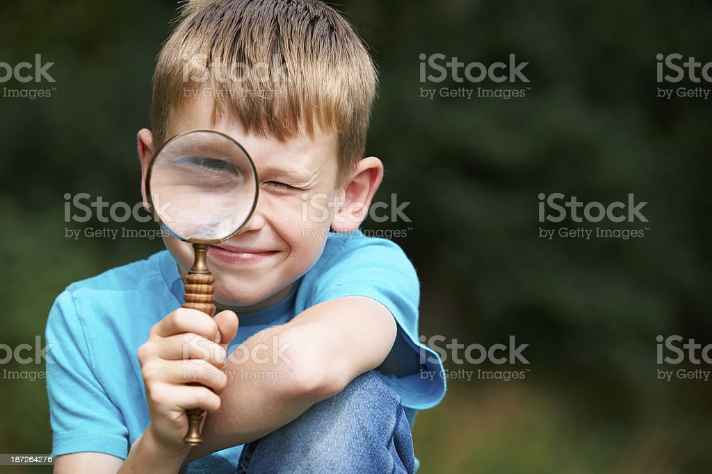 Boy Looking Through Magnifying Glass With Magnified Eye royalty-free stock photo