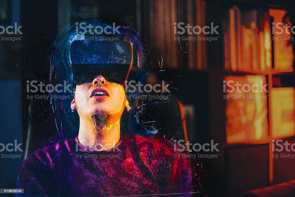 Boy looks fascinated into Virtual Reality Headset stock photo