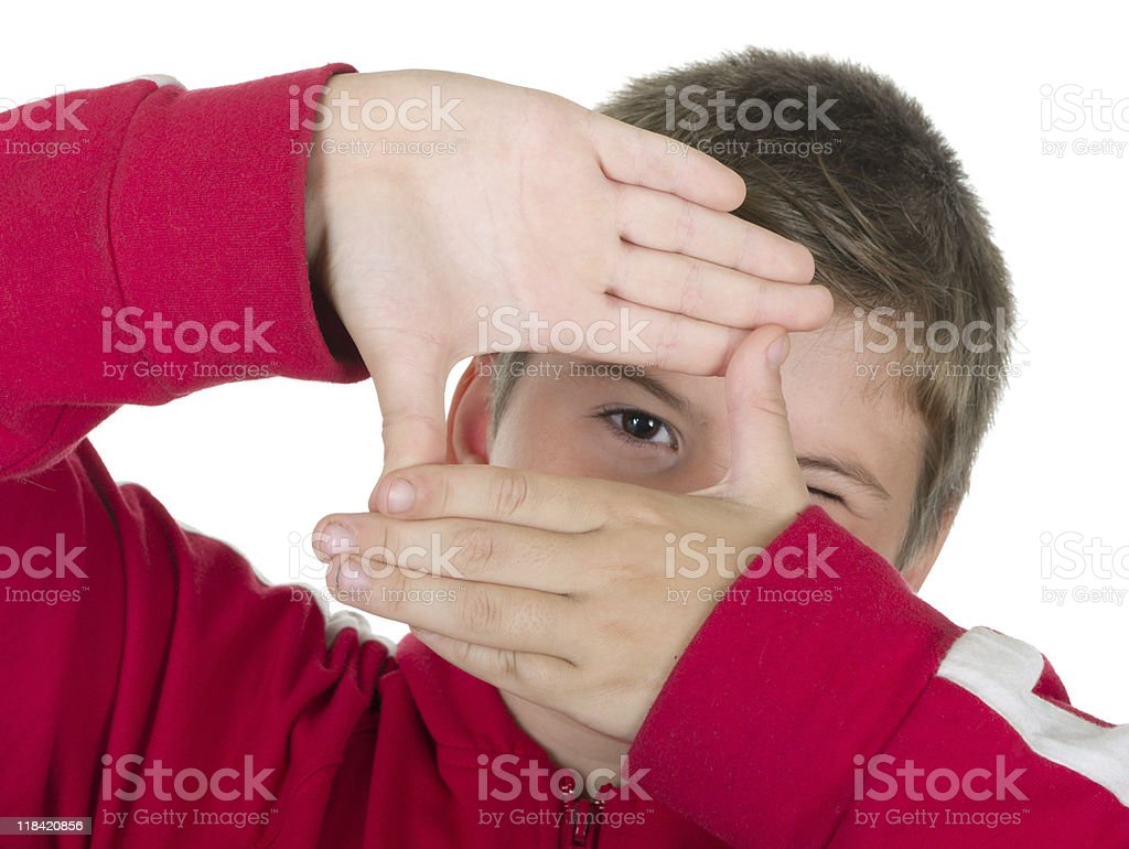 Boy looks through a framework from hands royalty-free stock photo