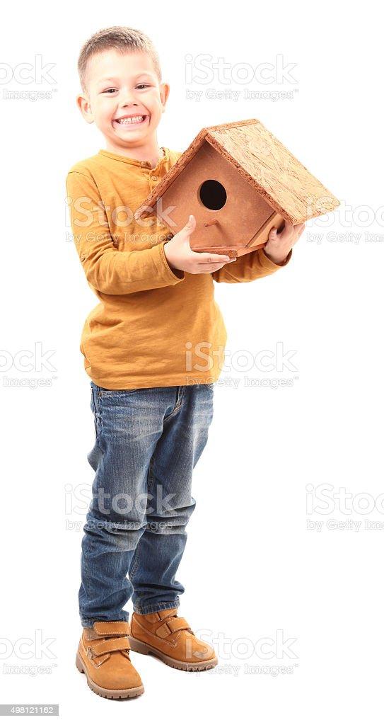 Boy made a wooden house for birds stock photo