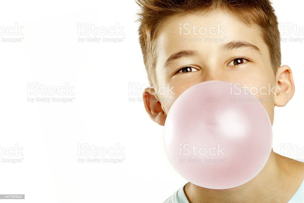 boy make bubble with chew stock photo