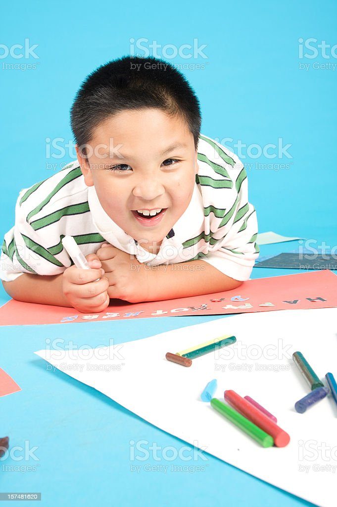 boy making a gift card royalty-free stock photo