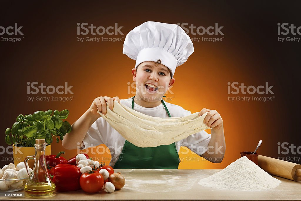 Boy making pizza dough royalty-free stock photo