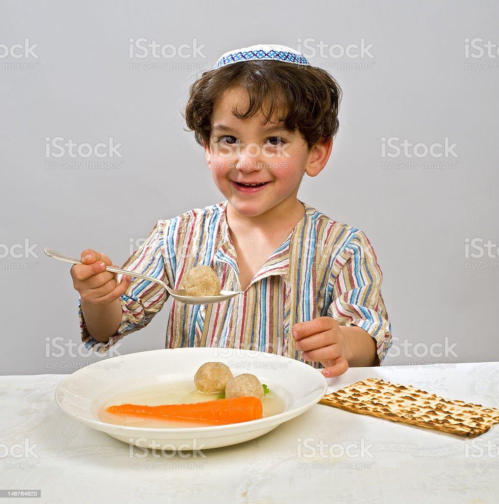 boy matzo ball soup stock photo