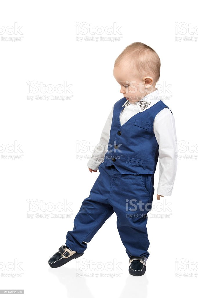 Boy neatly walks stock photo
