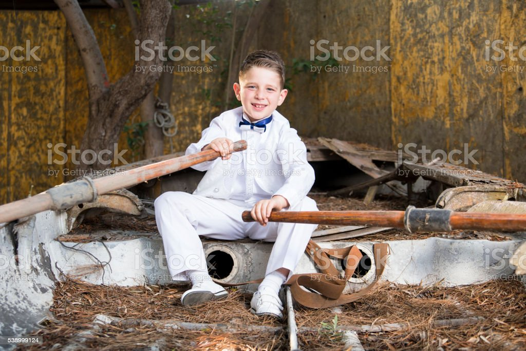 boy on a boat stock photo