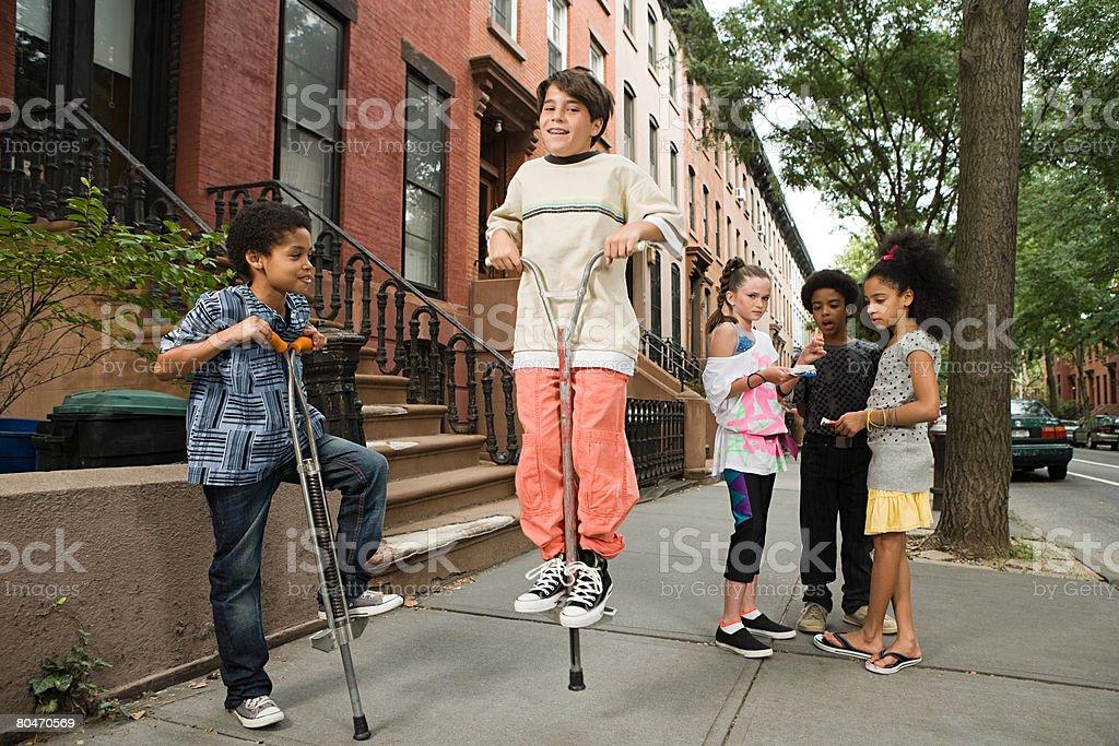 Boy on a pogo stick stock photo