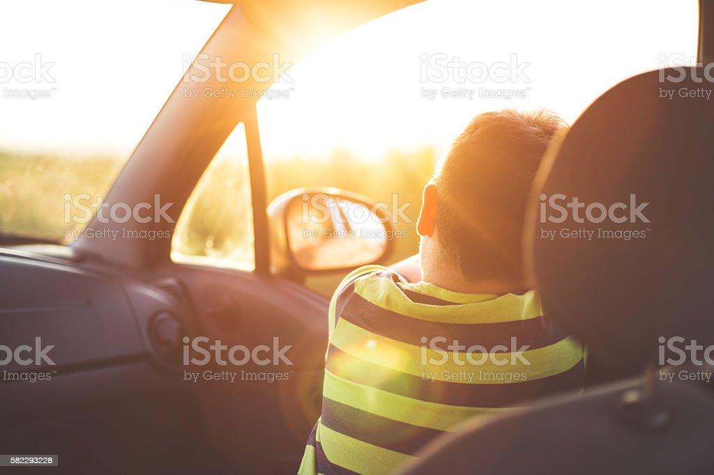 Boy on a road trip stock photo