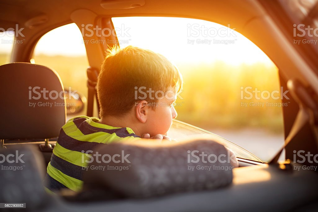 Boy on a road trip stock photo