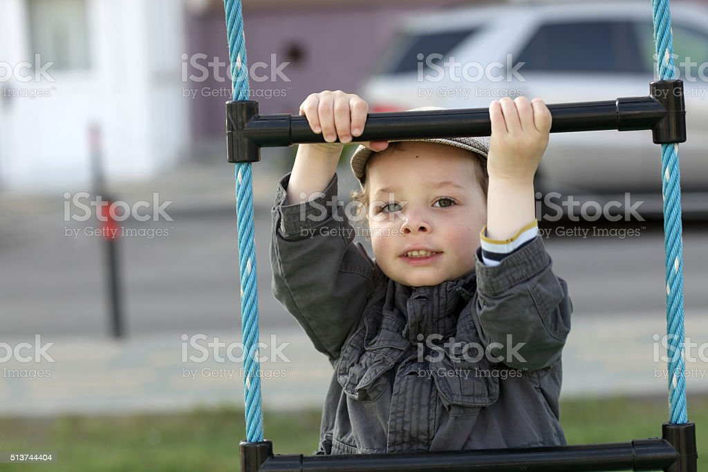 Boy on a rope ladder stock photo